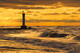 """Lighthouse at Sunset"""